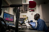 Eye Radio broadcast journalist SANTINO DOMINIC ATEM delivers the news in Arabic from the Juba station newsroom in South Sudan. In an effort to build up media and encourage a free media, USAID funded the station which is run by Internews.