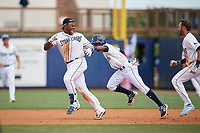 Charlotte Stone Crabs Moises Gomez (21) and Vidal Brujan (2) celebrate a walk-off win during a Florida State League game against the Dunedin Blue Jays on April 17, 2019 at Charlotte Sports Park in Port Charlotte, Florida.  Charlotte defeated Dunedin 4-3.  (Mike Janes/Four Seam Images)