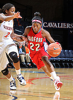 Dec. 6, 2010; Charlottesville, VA, USA; Radford Highlanders guard Da'Naria Erwin-Spencer (22) drives past Virginia Cavaliers guard Whitny Edwards (2) at the John Paul Jones Arena.  Mandatory Credit: Andrew Shurtleff-