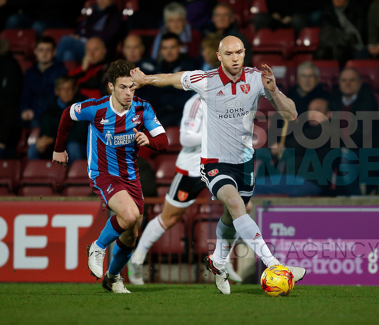 Conor Sammon of Sheffield Utd holds off Tommy Rowe of Scunthorpe Utd - English League One - Scunthorpe Utd vs Sheffield Utd - Glandford Park Stadium - Scunthorpe - England - 19th December 2015 - Pic Simon Bellis/Sportimage