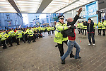 © Joel Goodman - 07973 332324 . 13/05/2013 . Manchester , UK . Police confront 100s of Manchester United fans outside the Manchester City store on Market Street after the Manchester United victory parade , this evening (13th May 2013) in Manchester City Centre . Photo credit : Joel Goodman