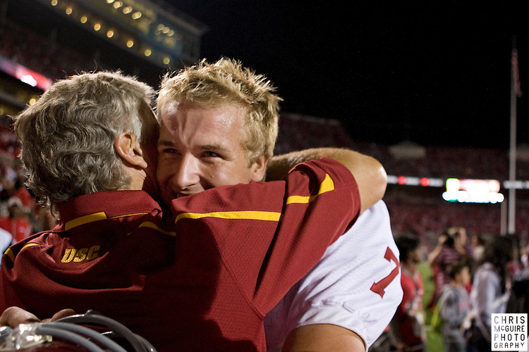 12 September 2009:  Football -- USC quarterback Matt Barkley celebrates their 18-15 victory over Ohio State with head coach Pete Carroll at Ohio Stadium in Columbus.  Photo by Christopher McGuire.