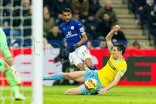 07.02.2015.  Leicester, England. Barclays Premier League. Leicester City versus Crystal Palace. Martin Kelly of Crystal Palace slides to stop a cross from Riyad Mahrez of Leicester City.