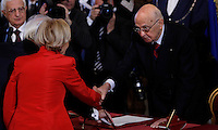 Il Ministro degli Esteri Emma Bonino stringe la mano al Presidente della Repubblica Giorgio Napolitano, a destra, alla cerimonia del giuramento del nuovo governo al Quirinale, Roma, 28 aprile 2013..Italian Foreign Minister Emma Bonino shakes hands with Head of State Giorgio Napolitano, right, during the swearing in ceremony of the new government at the Quirinale presidential palace Rome, 28 April 2013..UPDATE IMAGES PRESS/Isabella Bonotto