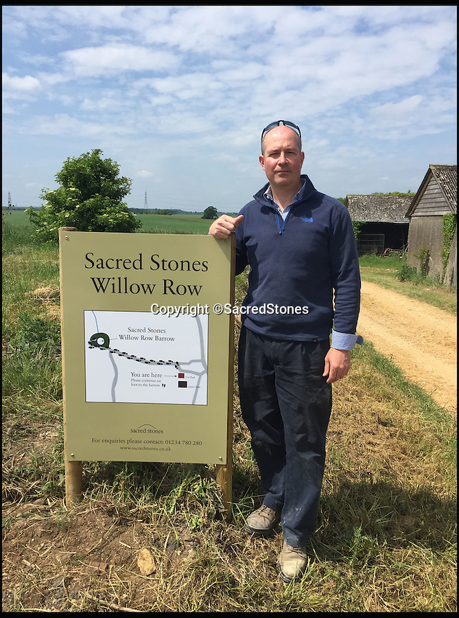 BNPS.co.uk (01202 558833)<br /> Pic: SacredStones/BNPS<br /> <br /> Toby Angel of Sacred Stones is behind the scheme.<br /> <br /> Building boom after 4000 years - Neolithic barrows are being built again as burial mounds for modern Britons.<br /> <br /> Prehistoric tombs used to store the ashes of loved ones are being built on UK soil for the first time in thousands of years. <br /> <br /> Until now Neolithic earth mounds built over the dead, known as long barrows, had not been used since around 2,000 BC. <br /> <br /> The limestone frame covered in soil and grass was entirely handmade by a team of four stonemasons using traditional techniques over the course of five months. <br /> <br /> The firm will be selling 400 plots, or niches, near Hail Weston, Cambs, for between £1,950 and £4,800.