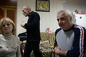 Vitali Kaloyev at home with friends in Vladikavkaz, in North Ossetia in southern Russia. .The 52-year-old architect, who killed the air traffic controller blamed for the plane crash in which he lost his wife and two children, is being treated as a national hero..Kaloyev, who was freed November 2007 from a Swiss jail after serving less than four years, was appointed deputy construction minister for his home region..Kaloyev was building a holiday villa in Spain for a wealthy Russian when his wife Svetlana, 44, 10-year-old son Konstantin and four-year-old daughter Diana, set out to join him for a holiday in July 2002. As their plane flew over Germany it collided with a cargo jet killing all 71 people on board, most of them Russian schoolchildren..Investigators later established that Peter Nielsen, a Dane working for Skyguide, the Swiss air-traffic control service at Zurich airport, was the only person on duty. He had panicked when he realised the two planes were on a collision course and gave wrong instructions to the pilots..Like other bereaved relatives, Kaloyev grew angry at the slow pace of the investigation and the way Skyguide, fearful of lawsuits, sought to place the blame on others..Kaloyev claims he cannot remember what happened next, but does not deny stabbing Nielsen several times with a pocket knife. Nielsen bled to death before an ambulance could reach him. Kaloyev was arrested the following day and was sentenced to eight years for manslaughter.