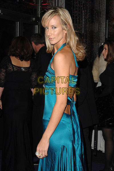 "LADY VICTORIA HERVEY.attending La Dolce Vita in aid of ""Debra""-  a charity that helps people with the genetic skin blistering condition Epidermolysis Bullosa (EB) at Battersea Evolution, Battersea Park, London, England, 12th December 2007..half length blue teal satin dress side back over shoulder.CAP/ BEL.©Tom Belcher/Capital Pictures."