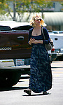 ..May 15th 2012 ..January Jones carrying a bag of bread food leaving Trader Joes market  wearing a Blue dress heart necklace brown gray purse bag leaving nail salon in Los Feliz just outside of Los Angeles. ..AbilityFilms@yahoo.com.805-427-3519.www.AbilityFilms.com..