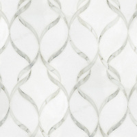 Sophie, a waterjet stone mosaic, shown in polished Calacatta Tia and honed Thassos, is part of the Silk Road Collection by Sara Baldwin for New Ravenna.