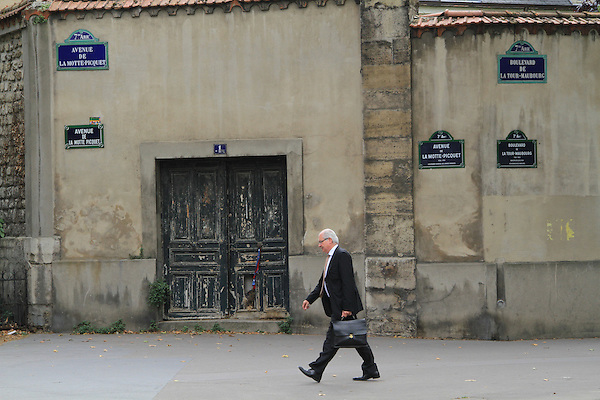 Older man with briefcase walking in Paris, France. .  John offers private photo tours in Denver, Boulder and throughout Colorado, USA.  Year-round. .  John offers private photo tours in Denver, Boulder and throughout Colorado. Year-round.
