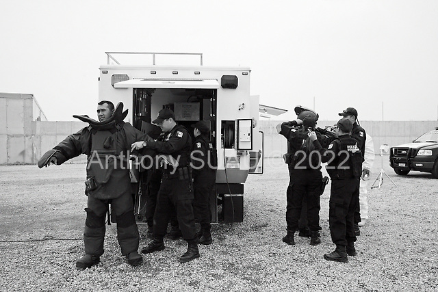 Mexico City, Mexico<br /> June 17, 2008<br /> <br /> Federal police officers suit up a bomb expert at the new federal police center.