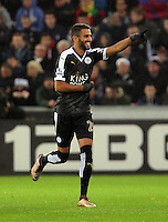 Riyad Mahrez of Leicester City celebrates his opening goal during the Barclays Premier League match between Swansea City and Leicester City at the Liberty Stadium, Swansea on December 05 2015