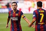 Barcelona´s Xavi Hernandez and Pedro during La Liga match between Rayo Vallecano and Barcelona at Vallecas stadium in Madrid, Spain. October 04, 2014. (ALTERPHOTOS/Victor Blanco)