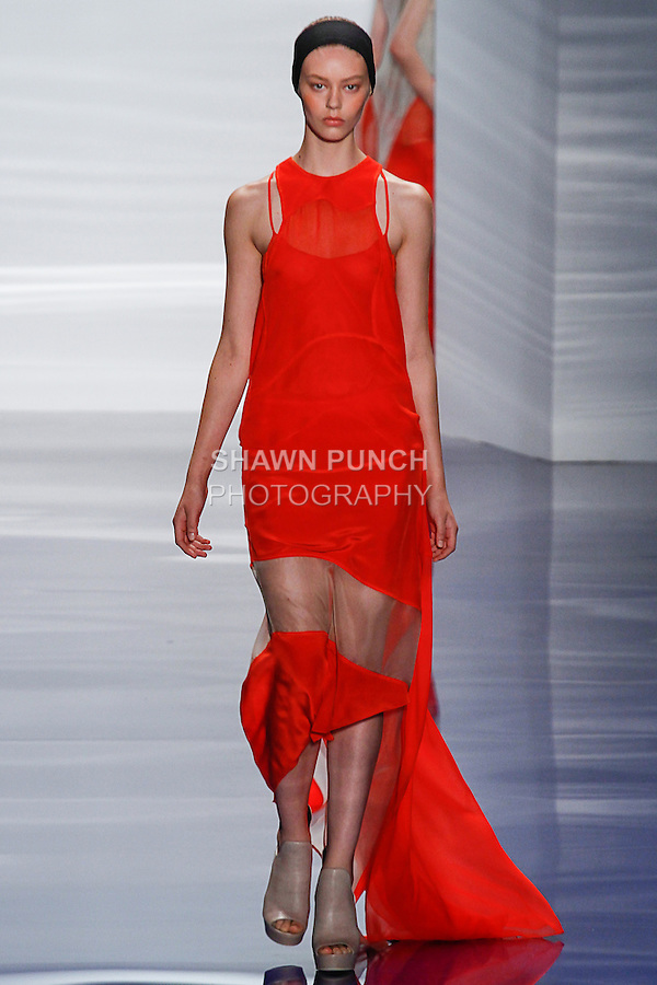 Model walks runway in an outfit from the Vera Wang Spring 2014 collection, during Mercedes-Benz Fashion Week Spring 2014 in New York.