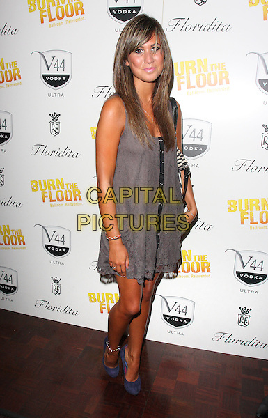 CIARA JANSON .'Burn the Floor' Press Night at the Shaftesbury Theatre, London, England, July 26th 2010..full length grey gray dress blue shoes suede .CAP/ROS.©Steve Ross/Capital Pictures