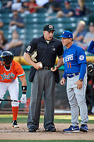 Las Vegas 51s manager Tony DeFrancesco (11) talks with home plate umpire John Libka during the game against the Salt Lake Bees at Smith's Ballpark on May 7, 2018 in Salt Lake City, Utah. The 51s defeated the Bees 10-8. (Stephen Smith/Four Seam Images)