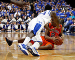 DeAndre Liggins dives after the ball held by Allen Payne in the second half of UK's win over the Auburn Tigers at Rupp Arena on Jan. 11, 2011. Photo by Britney McIntosh | Staff