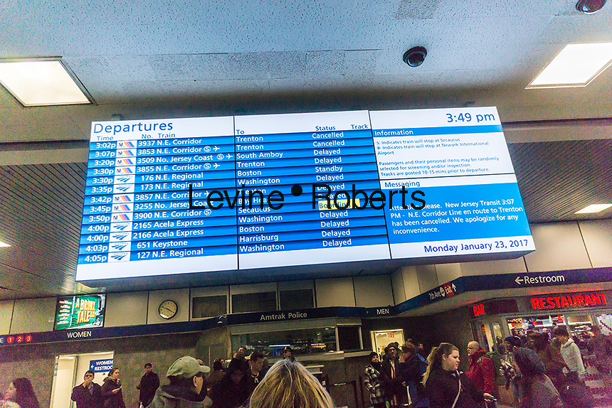 A digital Amtrak and NJ Transit departure board in Penn Station in New York on Monday, January 23, 2017 shows train service on Amtrak and NJ Transit has been severely disrupted with many trains cancelled because of the N'oreaster. (© Richard B. Levine)