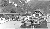 Passenger train and crowd at Ouray depot.  Parlor card &quot;Ouray&quot; on rear of train.<br /> D&amp;RG  Ouray, CO  ca. 1915