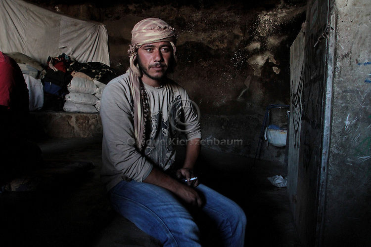 Mohammed Jabareen, 25 is seen in the cave he lives with his family in Jenba a Palestinian town of 50 families seats in an area called by the IDF as &ldquo;Firing Zone 918&rdquo; and is located in the southern Hebron hills near the town of Yatta.  Spread over 30,000 dunams, it includes twelve Palestinian villages.  According to OCHA figures, 1,622 people lived in the area in 2010, and according to local residents the number of inhabitants currently stands at about 1,800. For over a decade, the residents of twelve uniquely traditional Palestinian villages in the area of Masafer-Yatta in the south Hebron hills have lived under the constant threat of demolition, evacuation, and dispossession.<br /> The State's insistence on evacuation of Firing Zone 918 in part or in whole, if acceptance by the HCJ, might result in an immediate humanitarian disaster for almost two thousand souls, the destruction of villages, and the eradication of a remarkable way of life that has endured for centuries. Photo by Quique Kierszenbaum.