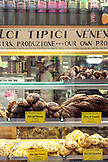 ITALY, Venice. Assorted cookies on display at a pastry shop.