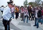"U.S. Park Police officers stop zombies from crossing the street to the Lincoln Memorial at dawn on Oct. 26, 2010. The zombies, who had planned to swarm the Lincoln Memorial, were part of a publicity campaign staged in major cities around the world for AMC's ""The Walking Dead,"" which premieres on Oct. 31."