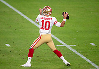 2nd February 2020, Miami Gardens, Florida, USA;  San Francisco 49ers Quarterback Jimmy Garoppolo (10) throws the ball during the NFL Super Bowl LIV  game between the Kansas City Chiefs and the San Francisco 49ers at the Hard Rock Stadium in Miami Gardens