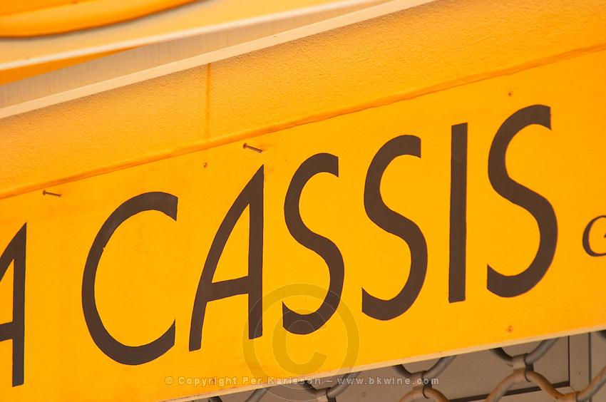 In Cassis village, a shop front painted iwth the name Cassis Cassis Cote d'Azur Var France Bouches du Rhone