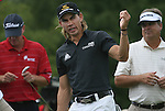 6 September 2008: Camillo Villegas (center) gestures as he and Steve Stricker (left) and Kenny Perry (at right) wait to tee off at the second hole on Saturday September 6, 2008  in the second round of play at the BMW Golf Championship at Bellerive Country Club in Town & Country, Missouri, a suburb of St. Louis, Missouri.  The BMW Championship is the third event on the PGA's Fed Ex Tour. Villegas (center) was the leader after the conclusion of the first round with a five-under par score.