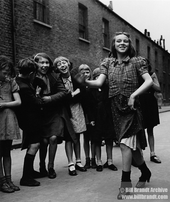 East End girl dancing the Lambeth Walk, 1937