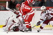 Kyle Richter (Harvard - 33), Zach Cohen (BU - 11), Alex Biega (Harvard - 3) - The Boston University Terriers defeated the Harvard University Crimson 6-5 in overtime on Tuesday, November 24, 2009, at Bright Hockey Center in Cambridge, Massachusetts.