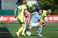 Seattle, WA - Sunday, April 17, 2016: Sky Blue FC midfielder Raquel Rodriguez (11) battles for the ball against Seattle Reign FC midfielder Jessica Fishlock (10). Sky Blue FC defeated the Seattle Reign FC 2-1 during a National Women's Soccer League (NWSL) match at Memorial Stadium.