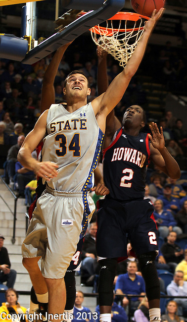 BROOKINGS, SD - NOVEMBER 25:  Cody Larson #34 from South Dakota State University makes a reverse lay-up past  Kofi Andoh #2 from Howard in the second half of their game Monday night at Frost Arena in Brookings. (Photo by Dave Eggen/Inertia)