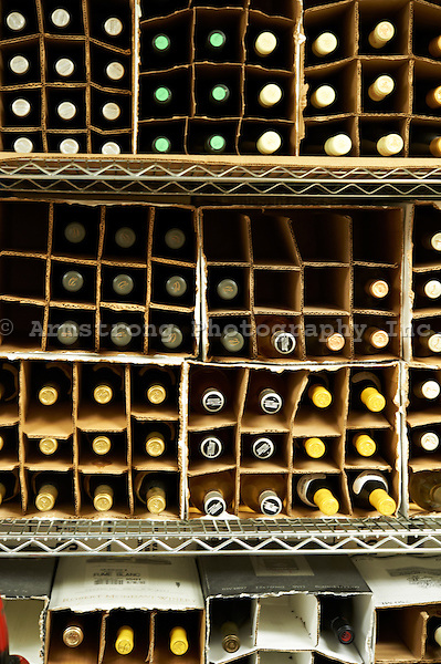 Boxes of wine turned on their side in a restaurant wine cellar