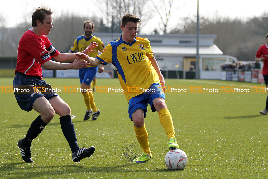Joe Maybanks of AFC Sudbury holds the ball up from David Hinton of Wroxham during AFC Sudbury vs Wroxham, Ryman League Divison 1 North Football at the Wardale Williams Stadium on 2nd April 2016