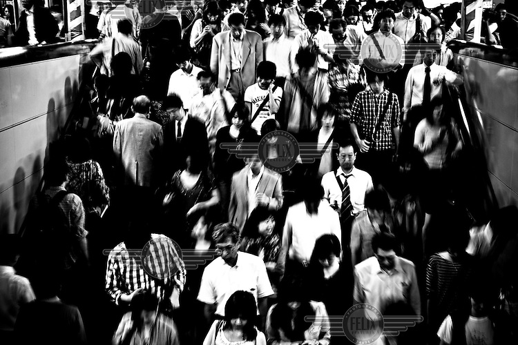 Commuters make their way during rush hour at a train station in Tokyo. As many as three in five people claimed they had been ill or felt unhealthy because of workplace conditions. That was markedly higher than the global average of 19 percent.