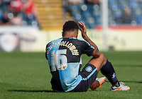 Aaron Amadi Holloway of Wycombe Wanderers is floored during the Sky Bet League 2 match between Wycombe Wanderers and York City at Adams Park, High Wycombe, England on 8 August 2015. Photo by Andy Rowland.