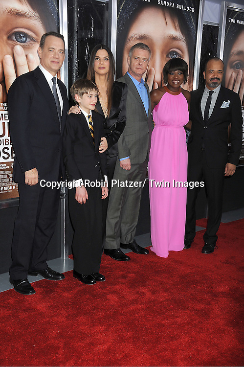"""Tom Hanks, Thomas Horn and Sandra Bullock, Stephen Daldry, Viola Davis and Jeffrey Wright attend the New York Premiere of """" Extremely Loud & Incredibly Close"""" on December 15, 2011 at The Ziegfeld Theatre in New York City. The movie stars Tom Hanks, Sandra Bullock, Thomas Horn, Max von Sydow, Viola Davis and Jeffrey Wright."""