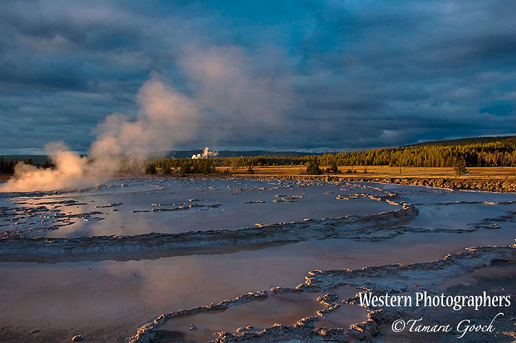 A photograph of Fountain Geyser at sunset