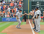 Masahiro Tanaka (Yankees),<br /> APRIL 1, 2014 - MLB :<br /> Masahiro Tanaka of the New York Yankees gets fist-bumps from his teammates during introductions before the baseball game against the Houston Astros at Minute Maid Park in Houston, Texas, United States. (Photo by AFLO)