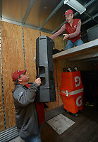 NWA Democrat-Gazette/ANDY SHUPE<br />Jerry Rico (right) of Fayetteville and Rodney Collins of Pensacola, Fla., lift equipment Thursday, Nov. 9, 2017, into the loft of a 53-foot semi-trailer before heading out to Baton Rouge, La., ahead of the Razorbacks' game with LSU Saturday. Rico and Collins are employees of J.B. Hunt Transport and the work together to drive equipment necessary for the Razorbacks football team to and from games away from Fayetteville.