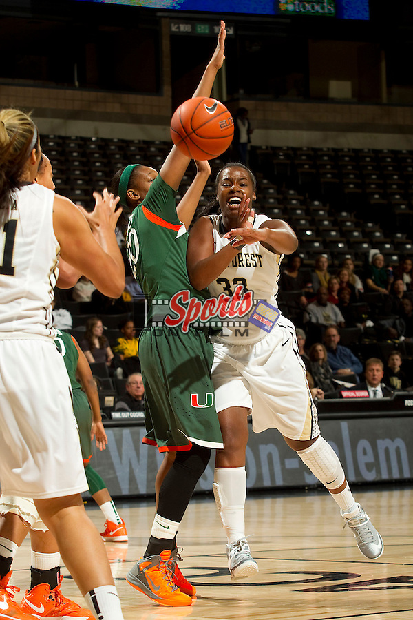 Asia Williams (33) of the Wake Forest Demon Deacons passes the ball during first half action against the Miami Hurricanes at the LJVM Coliseum on January 24, 2013 in Winston-Salem, North Carolina.  The Hurricanes defeated the Demon Deacons 79-78.    (Brian Westerholt/Sports On Film)