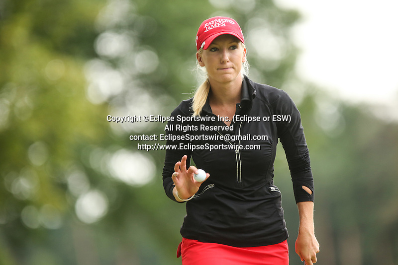 Brooke Pancake waves to the fans on the 9th green at the LPGA Championship 2014 Sponsored By Wegmans at Monroe Golf Club in Pittsford, New York on August 16, 2014