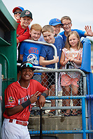 Batavia Muckdogs Brayan Hernandez (18) poses for a photo with a group of young fans before a game against the Auburn Doubledays on September 2, 2018 at Dwyer Stadium in Batavia, New York.  Batavia defeated Auburn 5-4.  (Mike Janes/Four Seam Images)