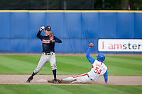 14 September 2009: Jason Holowaty of Great Britain throws the ball for the double play as Young-Hun Cho of South Korea slides during the 2009 Baseball World Cup Group F second round match game won 15-5 by South Korea over Great Britain, in the Dutch city of Amsterdan, Netherlands.