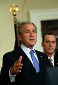 United States President George W. Bush makes a statement on aviation congestion in the Roosevelt Room of the White House in Washington, DC on November 15, 2007.  Standing with the President is Robert A. Sturgell, Deputy Administrator of the Federal Aviation Administration.<br /> Credit: Aude Guerrucci / Pool via CNP