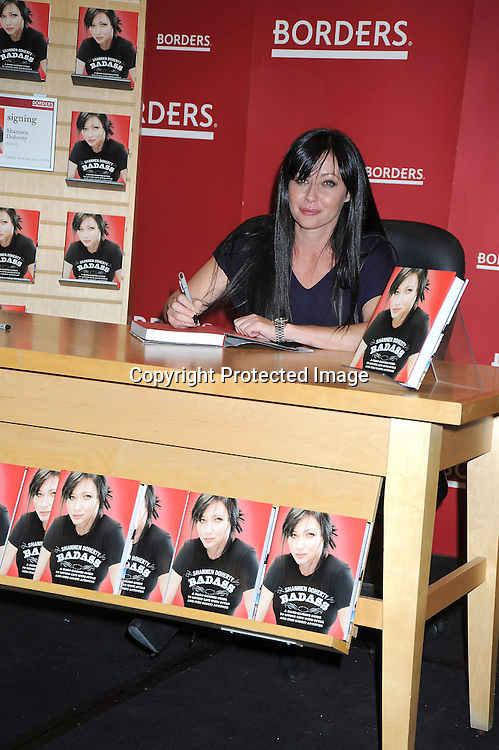 """Shannen Doherty posing for photographers at her book signing of """"Badass"""" on November 2, 2010.at Borders at The Time Warner Center in New York City. .photo by Robin Platzer/ Twin Images"""