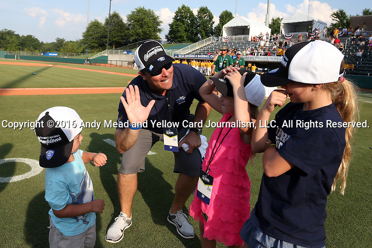 04 June 2016: Nova Southeastern Director of Athletics Michael Mominey with head coach Greg Brown's (not pictured) children Kruz, Kooper, and Kennadi. The Nova Southeastern University Sharks played the Millersville University Marauders in Game 14 of the 2016 NCAA Division II College World Series  at Coleman Field at the USA Baseball National Training Complex in Cary, North Carolina. Nova Southeastern won the game 8-6 and clinched the NCAA Division II Baseball Championship.