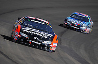 Oct. 10, 2009; Fontana, CA, USA; NASCAR Nationwide Series driver Kyle Busch (20) leads Joey Logano during the Copart 300 at Auto Club Speedway. Mandatory Credit: Mark J. Rebilas-