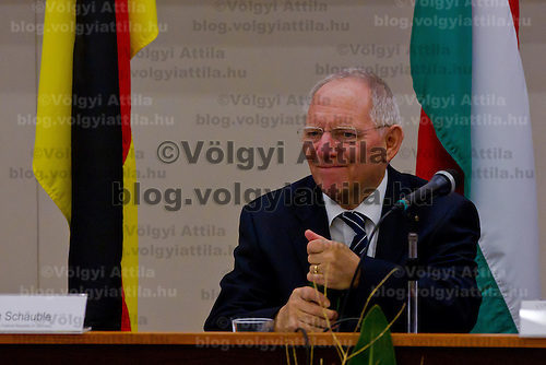 Wolfgang Schaeuble Finance Minister for Germany opens a bottle of water during the Europe on Crossroads conference organized by Corvinus University in Budapest, Hungary on December 05, 2011. ATTILA VOLGYI